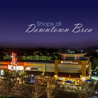 A shopping center photographed at night, links to Production portfolio